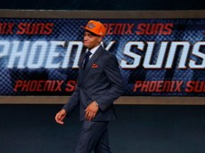 NEW YORK, NY - JUNE 26:  Tyler Ennis of Syracuse walks on stage after being drafted with the #18 overall pick by the Phoenix Suns during the 2014 NBA Draft at Barclays Center on June 26, 2014 in the Brooklyn borough of New York City. NOTE TO USER: User expressly acknowledges and agrees that, by downloading and/or using this Photograph, user is consenting to the terms and conditions of the Getty Images License Agreement.  (Photo by Mike Stobe/Getty Images)