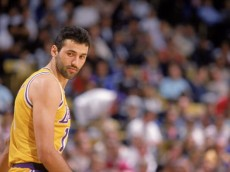 LOS ANGELES - 1989:  Vlade Divac #12 of the Los Angeles Lakers stands on the court during an NBA game at the Great Western Forum in Los Angeles, California in 1989. (Photo by Mike Powell/Getty Images)