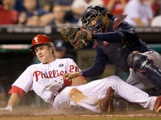 PHILADELPHIA, PA - SEPTEMBER 27: Second baseman Chase Utley #26 of the Philadelphia Phillies is tagged out at home by catcher Christian Bethancourt #25 of the Atlanta Braves in the bottom of the fourth inning on September 27, 2014 at Citizens Bank Park in Philadelphia, Pennsylvania. The Braves defeated the Phillies 4-2. (Photo by Mitchell Leff/Getty Images)