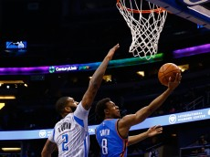 ORLANDO, FL - JANUARY 18:  Ish Smith #8 of the Oklahoma City Thunder attempts a shot against Kyle O'Quinn #2 of the Orlando Magic during the game at Amway Center on January 18, 2015 in Orlando, Florida. NOTE TO USER: User expressly acknowledges and agrees that, by downloading and or using this photograph, User is consenting to the terms and conditions of the Getty Images License Agreement.  (Photo by Sam Greenwood/Getty Images)