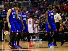 WASHINGTON, DC - JANUARY 19: Furkan Aldemir #19, Hollis Thompson #31, Jerami Grant #39 and JaKarr Sampson #9 of the Philadelphia 76ers walk off the court during a timeout against the Washington Wizards at Verizon Center on January 19, 2015 in Washington, DC. The Wizards won 111-76. NOTE TO USER: User expressly acknowledges and agrees that, by downloading and or using this photograph, User is consenting to the terms and conditions of the Getty Images License Agreement.  (Photo by Rob Carr/Getty Images)