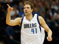 DALLAS, TX - JANUARY 27:  Dirk Nowitzki #41 of the Dallas Mavericks reacts as the Mavericks take on the Memphis Grizzlies at American Airlines Center on January 27, 2015 in Dallas, Texas. NOTE TO USER: User expressly acknowledges and agrees that, by downloading and or using this photograph, User is consenting to the terms and conditions of the Getty Images License Agreement.  (Photo by Tom Pennington/Getty Images)