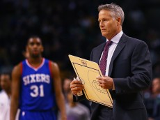 BOSTON, MA - FEBRUARY 06:  Brett Brown, head coach of the Philadelphia 76ers calls a time out during the second quarter against the Boston Celtics at TD Garden on February 6, 2015 in Boston, Massachusetts.  (Photo by Maddie Meyer/Getty Images) NOTE TO USER: User expressly acknowledges and agrees that, by downloading and/or using this photograph, user is consenting to the terms and conditions of the Getty Images License Agreement.
