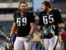 PHILADELPHIA, PA - DECEMBER 01:  Evan Mathis #69 of the Philadelphia Eagles and Lane Johnson #65 walk off of the field following the game against the Arizona Cardinals at Lincoln Financial Field on December 1, 2013 in Philadelphia, Pennsylvania. The Eagles defeat the Cardinals 24-21. (Photo by Maddie Meyer/Getty Images)