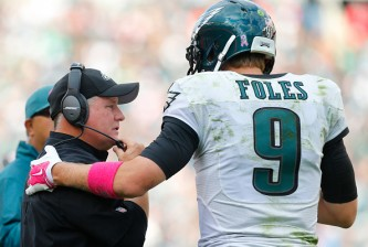 PHILADELPHIA, PA - OCTOBER 5: Head coach Chip Kelly of the Philadelphia Eagles talks with quarterback Nick Foles #9 in the fourth quarter against the St. Louis Rams on October 5, 2014 at Lincoln Financial Field in Philadelphia, Pennsylvania. The Eagles defeated the Rams 34-28 (Photo by Rich Schultz/Getty Images)