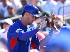 MESA, AZ - MARCH 24:  Kris Bryant #76 of the Chicago Cubs celebrates with teammates after hitting a third-inning home run against the Oakland Athletics in a preseason Cactus League game at HoHokam Stadium on March 24, 2015 in Mesa, Arizona.  (Photo by Norm Hall/Getty Images)