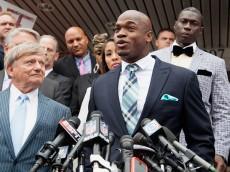 "CONROE, TX - NOVEMBER 04:  Defense attorney Rusty Hardin, (L) and NFL running back Adrian Peterson of the of the Minnesota Vikings address the media after Peterson plead ""no contest"" to a lesser misdemeanor charge of reckless assault on November 4, 2014 in Conroe, Texas. Peterson's plea to the Class A misdemeanor comes with two years of deferred adjudication. Peterson also received a $4,000 fine and 80 hours of required community service.  (Photo by Bob Levey/Getty Images)"