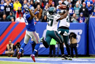 EAST RUTHERFORD, NJ - DECEMBER 28:  Malcolm Jenkins #27 and  Nolan Carroll #23 of the Philadelphia Eagles defend against Odell Beckham #13 of the New York Giants during a game at MetLife Stadium on December 28, 2014 in East Rutherford, New Jersey.  (Photo by Al Bello/Getty Images)