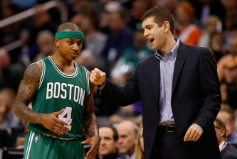 PHOENIX, AZ - FEBRUARY 23:  Head coach Brad Stevens of the Boston Celtics talks with Isaiah Thomas #4 during the second half of the NBA game against the Phoenix Suns at US Airways Center on February 23, 2015 in Phoenix, Arizona. The Celtics defeated the Suns 115-110. NOTE TO USER: User expressly acknowledges and agrees that, by downloading and or using this photograph, User is consenting to the terms and conditions of the Getty Images License Agreement.  (Photo by Christian Petersen/Getty Images)