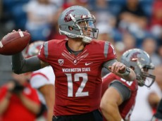 SEATTLE, WA - AUGUST 28:  Quarterback Connor Halliday #12 of the Washington State Cougars passes against the Rutgers Scarlet Knights at CenturyLink Field on August 28, 2014 in Seattle, Washington.  (Photo by Otto Greule Jr/Getty Images)