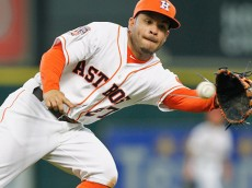 HOUSTON, TX - APRIL 19:  Jose Altuve #27 of the Houston Astros fields a ground ball by Matt Joyce #20 of the Los Angeles Angels of Anaheim in the sixth inning at Minute Maid Park on April 19, 2015 in Houston, Texas.  (Photo by Bob Levey/Getty Images)