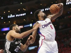 LOS ANGELES, CA - MAY 02:   DeAndre Jordan #6 of the Los Angeles Clippers grabs a rebound over Tim Duncan #21 of the San Antonio Spurs during Game Seven of the Western Conference quarterfinals of the 2015 NBA Playoffs at Staples Center on May 2, 2015 in Los Angeles, California.  The Clippers won 111-109 to win the series four games to three.  NOTE TO USER: User expressly acknowledges and agrees that, by downloading and or using this photograph, User is consenting to the terms and conditions of the Getty Images License Agreement.  (Photo by Stephen Dunn/Getty Images)