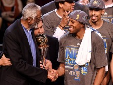 CLEVELAND, OH - JUNE 16:  Bill Russell and Andre Iguodala #9 of the Golden State Warriors shake hands after he receives the 2015 NBA Finals MVP award following their win over the Cleveland Cavaliers in Game Six of the 2015 NBA Finals at Quicken Loans Arena on June 16, 2015 in Cleveland, Ohio. NOTE TO USER: User expressly acknowledges and agrees that, by downloading and or using this photograph, user is consenting to the terms and conditions of Getty Images License Agreement.  (Photo by Jason Miller/Getty Images)