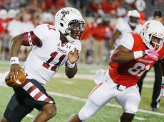 HOUSTON, TX - OCTOBER 17:  P.J. Walker #11 of the Temple Owls scrambles past Tyus Bowser #81 of the Houston Cougars in the first half of their game at TDECU Stadium on October 17, 2014 in Houston, Texas.  (Photo by Scott Halleran/Getty Images)