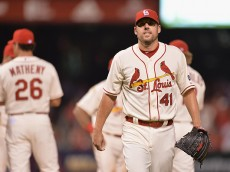 ST. LOUIS, MO - AUGUST 15: John Lackey #41 of the St. Louis Cardinals is relieved from pitching against the Miami Marlins in the ninth inning at Busch Stadium on August 15, 2015 in St. Louis, Missouri.  (Photo by Michael Thomas/Getty Images)