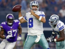 ARLINGTON, TX - AUGUST 29:   Tony Romo #9 of the Dallas Cowboys looks for an open receiver under pressure from  Everson Griffen #97 of the Minnesota Vikings in the first quarter on August 29, 2015 in Arlington, Texas.  (Photo by Tom Pennington/Getty Images)