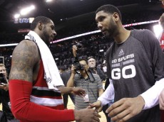 SAN ANTONIO, TX - MAY 14:  Tim Duncan #21 of the San Antonio Spurs and LaMarcus Aldridge #12 of the Portland Trail Blazers shake hands after the Spurs defeat the Trail Blazers 104-82 in Game Five of the Western Conference Semifinals during the 2014 NBA Playoffs at the AT&T Center on May 14, 2014 in San Antonio, Texas. NOTE TO USER: User expressly acknowledges and agrees that, by downloading and/or using this photograph, user is consenting to the terms and conditions of the Getty Images License Agreement. (Photo by Chris Covatta/Getty Images)