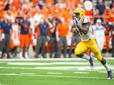 SYRACUSE, NY - SEPTEMBER 26:  Leonard Fournette #7 of the LSU Tigers runs for a touchdown during the third quarter pushing their lead to 24-10 on September 26, 2015 at The Carrier Dome in Syracuse, New York.  LSU defeats Syracuse 34-24.  (Photo by Brett Carlsen/Getty Images)