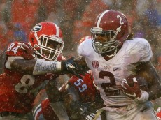 ATHENS, GA - OCTOBER 03:  Derrick Henry #2 of the Alabama Crimson Tide tries to break a tackle by Leonard Floyd #84 of the Georgia Bulldogs at Sanford Stadium on October 3, 2015 in Athens, Georgia.  (Photo by Kevin C. Cox/Getty Images)
