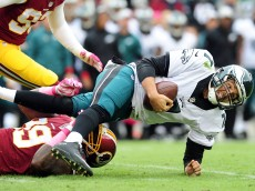 LANDOVER, MD - OCTOBER 04: Sam Bradford #7 of the Philadelphia Eagles is tackled by Ricky Jean Francois #99 of the Washington Redskins in the second quarter at FedExField on October 4, 2015 in Landover, Maryland.  (Photo by Evan Habeeb/Getty Images)