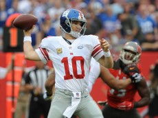 TAMPA, FL - NOVEMBER 8: Quarterback Eli Manning #10 of the New York Giants throws a pass against the Tampa Bay Buccaneers at Raymond James Stadium on November 8, 2015 in Tampa, Florida. (Photo by Cliff McBride/Getty Images) *** Local Caption ***Eli Manning