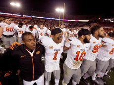 AMES, IA - NOVEMBER 14: Cornerback Kevin Peterson #1 of the Oklahoma State Cowboys celebrates with his teammates after they defeated the Iowa State Cyclones 35-31at Jack Trice Stadium on November 14, 2015 in Ames, Iowa. The Oklahoma State Cowboys defeated Iowa State 35-31.(Photo by David Purdy/Getty Images)
