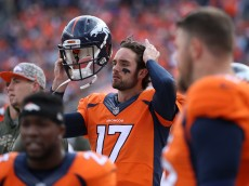 DENVER, CO - NOVEMBER 15:  Quarterback Brock Osweiler #17 of the Denver Broncos looks on from the bench Kansas City Chiefs at Sports Authority Field at Mile High on November 15, 2015 in Denver, Colorado. The Chiefs defeated the Broncos 29-13.  (Photo by Doug Pensinger/Getty Images)
