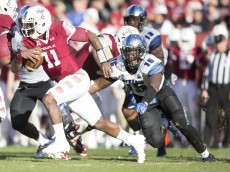 PHILADELPHIA, PA - NOVEMBER 21: P.J. Walker #11 of the Temple Owls runs past Christian Johnson #15 of the Memphis Tigers on November 21, 2015 at Lincoln Financial Field in Philadelphia, Pennsylvania. The Owls defeated the Tigers 31-12. (Photo by Mitchell Leff/Getty Images) *** Local Caption *** P.J. Walker;Christian Johnson