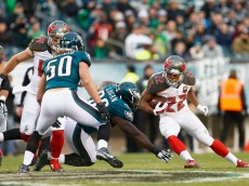 PHILADELPHIA, PA - NOVEMBER 22:  Doug Martin #22 of the Tampa Bay Buccaneers runs the ball against Bennie Logan #96 of the Philadelphia Eagles in the third quarter at Lincoln Financial Field on November 22, 2015 in Philadelphia, Pennsylvania.  (Photo by Rich Schultz/Getty Images)