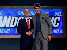 NEW YORK, NY - JUNE 26:  Dario Saric of Croatia (R) shakes hands with NBA Commissioner Adam Silver after being drafted with the #12 overall pick by the Orlando Magic during the 2014 NBA Draft at Barclays Center on June 26, 2014 in the Brooklyn borough of New York City. NOTE TO USER: User expressly acknowledges and agrees that, by downloading and/or using this Photograph, user is consenting to the terms and conditions of the Getty Images License Agreement.  (Photo by Mike Stobe/Getty Images)
