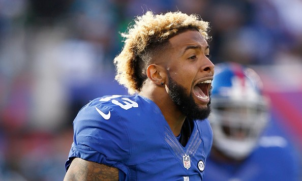 EAST RUTHERFORD, NJ - DECEMBER 20:  Odell Beckham #13 of the New York Giants reacts after a scuffle in the first quarter against the Carolina Panthers during their game at MetLife Stadium on December 20, 2015 in East Rutherford, New Jersey.  (Photo by Jeff Zelevansky/Getty Images)