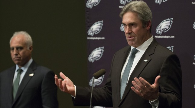 PHILADELPHIA, PA - JANUARY 19: New Philadelphia Eagles head coach Doug Pederson speaks to the media with owner Jeffrey Lurie in the background on January 19, 2016 at the NovaCare Complex in Philadelphia, Pennsylvania. (Photo by Mitchell Leff/Getty Images)