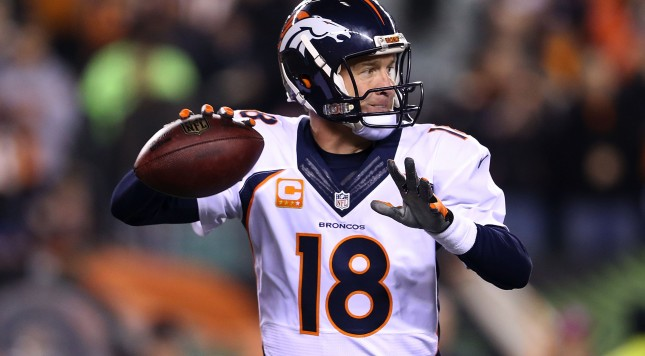 CINCINNATI, OH - DECEMBER 22:  Peyton Manning #18 of the Denver Broncos drops back to throw a pass during the first quarter of the game against the Cincinnati Bengals at Paul Brown Stadium on December 22, 2014 in Cincinnati, Ohio. (Photo by Andy Lyons/Getty Images)