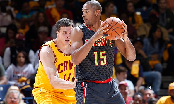 CINCINNATI, OH - OCTOBER 7:  Al Horford #15 of the Atlanta Hawks handles the ball against Sasha Kaun #14 of the Cleveland Cavaliers in the first half of a preseason game at Cintas Center on October 7, 2015 in Cincinnati, Ohio. The Hawks defeated the Cavaliers 98-96. NOTE TO USER: User expressly acknowledges and agrees that, by downloading and or using the photograph, User is consenting to the terms and conditions of the Getty Images License Agreement. (Photo by Joe Robbins/Getty Images)