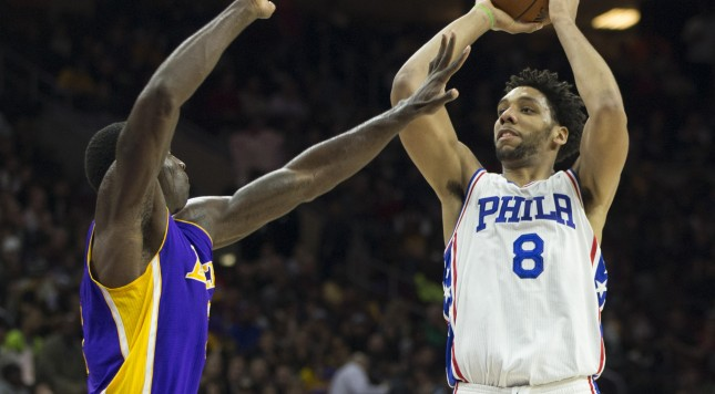 PHILADELPHIA, PA - DECEMBER 1: Jahlil Okafor #8 of the Philadelphia 76ers attempts a shot over Brandon Bass #2 of the Los Angeles Lakers on December 1, 2015 at the Wells Fargo Center in Philadelphia, Pennsylvania. NOTE TO USER: User expressly acknowledges and agrees that, by downloading and or using this photograph, User is consenting to the terms and conditions of the Getty Images License Agreement. The 76ers defeated the Lakers 103-91. (Photo by Mitchell Leff/Getty Images)