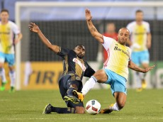 COLUMBUS, OH - MARCH 12:  Warren Creavalle #2 of the Philadelphia Union and Federico Higuain #10 of the Columbus Crew SC slide in as they battle for control of the ball in the second half on March 12, 2016 at MAPFRE Stadium in Columbus, Ohio.  Philadelphia defeated Columbus 2-1.  (Photo by Jamie Sabau/Getty Images)