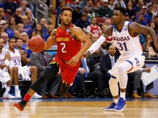LOUISVILLE, KY - MARCH 24:  Melo Trimble #2 of the Maryland Terrapins drives against Jamari Traylor #31 of the Kansas Jayhawks in the first half during the 2016 NCAA Men's Basketball Tournament South Regional at KFC YUM! Center on March 24, 2016 in Louisville, Kentucky.  (Photo by Kevin C. Cox/Getty Images)