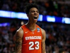 CHICAGO, IL - MARCH 27:  Malachi Richardson #23 of the Syracuse Orange celebrates their 68 to 62 win over the Virginia Cavaliers with teammates during the 2016 NCAA Men's Basketball Tournament Midwest Regional Final at United Center on March 27, 2016 in Chicago, Illinois.  (Photo by Jonathan Daniel/Getty Images)