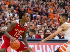SYRACUSE, NY - FEBRUARY 27:  Anthony Barber #12 of the North Carolina State Wolfpack sets the play as Michael Gbinije #0 of the Syracuse Orange defends during the second half on February 27, 2016 at The Carrier Dome in Syracuse, New York.  Syracuse defeats NC State 75-66.  (Photo by Brett Carlsen/Getty Images) *** Local Caption *** Anthony Barber