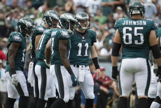 PHILADELPHIA, PA - SEPTEMBER 11: Carson Wentz #11 of the Philadelphia Eagles stands in the huddle with Josh Huff #13, Zach Ertz #86, Jordan Matthews #81, Nelson Agholor #17, and Lane Johnson #65 during the game against the Cleveland Browns at Lincoln Financial Field on September 11, 2016 in Philadelphia, Pennsylvania. The Eagles defeated the Browns 29-10. (Photo by Mitchell Leff/Getty Images)