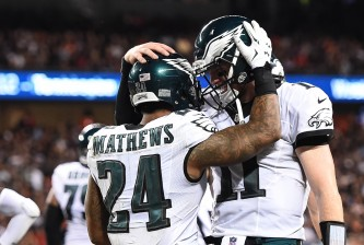 CHICAGO, IL - SEPTEMBER 19:   Ryan Mathews #24 and quarterback Carson Wentz #11 of the Philadelphia Eagles celebrate after Mathews scored a touchdown in the third quarter against the Chicago Bears at Soldier Field on September 19, 2016 in Chicago, Illinois.  (Photo by Stacy Revere/Getty Images)