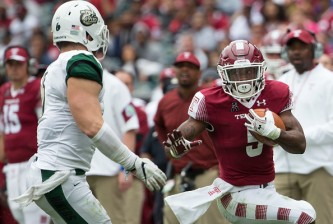 PHILADELPHIA, PA - SEPTEMBER 24: Jahad Thomas #5 of the Temple Owls runs the ball against Nick Cook #6 of the Charlotte 49ers at Lincoln Financial Field on September 24, 2016 in Philadelphia, Pennsylvania. (Photo by Mitchell Leff/Getty Images)