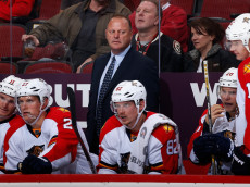 GLENDALE, AZ - OCTOBER 25:  Head coach Gerard Gallant of the Florida Panthers watches from the bench during the NHL game against the Arizona Coyotes at Gila River Arena on October 25, 2014 in Glendale, Arizona.  (Photo by Christian Petersen/Getty Images)