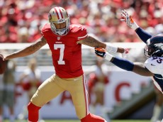 SANTA CLARA, CA - AUGUST 17:  Quarterback Colin Kaepernick #7 of the San Francisco 49ers runs from defensive end Quanterus Smith #93 of the Denver Broncos during a preseason game at Levi's Stadium on August 17, 2014 in Santa Clara, California.  (Photo by Ezra Shaw/Getty Images)