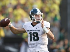 EUGENE, OR - SEPTEMBER 6: Connor Cook #18 of the Michigan State Spartans passes the ball in the second half of the game against the Oregon Ducks at Autzen Stadium on September 6, 2014 in Eugene, Oregon. Oregon won 46-27. (Photo by Joe Robbins/Getty Images)