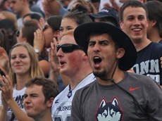 A UConn student celebrates after Ron Johnson's touchdown during the UConn Huskies vs Army Black Knights football game at Pratt & Whitney Stadium at Rentschler Field in East Hartford, CT.