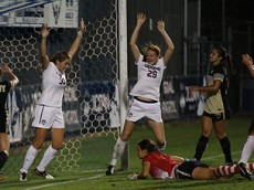 UConn's Sabrina Toole (33) celebrates with Tanya Altrui (29) after Altrui's goal during the UConn Huskies vs Army Black Knights women's soccer game at Morrone Stadium in Storrs, CT.