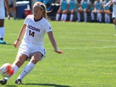 UConn's Samantha McGuire (14) sends the ball down field during the UConn Huskies vs Harvard Crimson women's soccer game at Morrone Stadium in Storrs, CT.