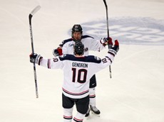 UConn's Miles Gendron (10) celebrates with Evan Richardson after Richardson's goal during the UConn Huskies vs Boston University Terriers men's college hockey game at the XL Center in Hartford, CT on October 27, 2015.