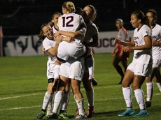 UConn's Samantha McGuire (14) holds up Heidi Druehl (12) after McGuire's goal during the UConn Huskies vs Houston Cougars women's soccer game at Joseph J. Morrone Stadium in Storrs, CT on October 22, 2015.
